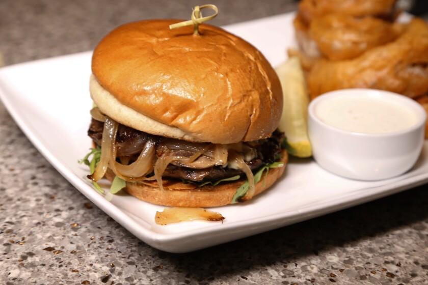 The Black & Bleu Burger at Tony Gwynn's Sports Pub at Jamul Casino, has a special grind beef patty, gorgonzola, sautéed mushrooms, caramelized onions, arugula and garlic aioli.