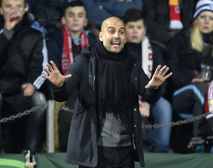 Bayern head coach Pep Guardiola reacts during the  German Soccer Cup quarterfinal  match between VfL Bochum and Bayern Munich in Bochum, Germany, Wednesday, Feb. 10, 2016. (AP Photo/Martin Meissner)