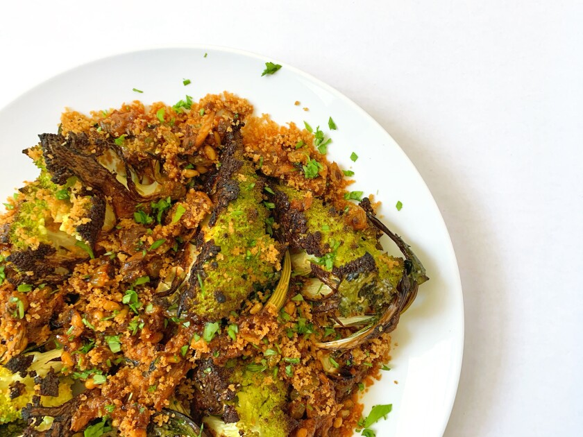 Roasted romanesco with a sauce of pine nuts, golden raisins, saffron and sardines