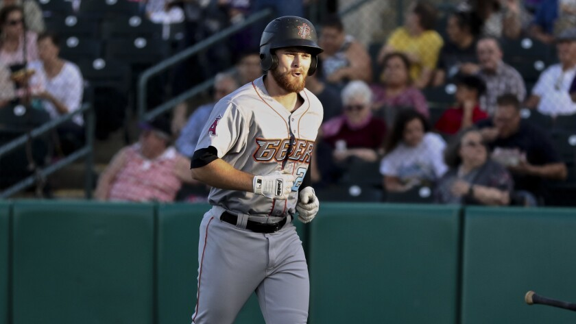 Inland Empire's Jared Walsh is all smiles after hitting a home run against the Lancaster JetHawks at