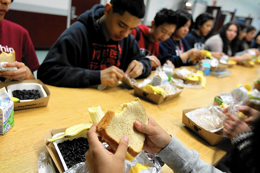 Students eat lunch at Francisco Bravo Medical Magnet High School in Los Angeles. Districts in California tend to support the federal nutrition rules.