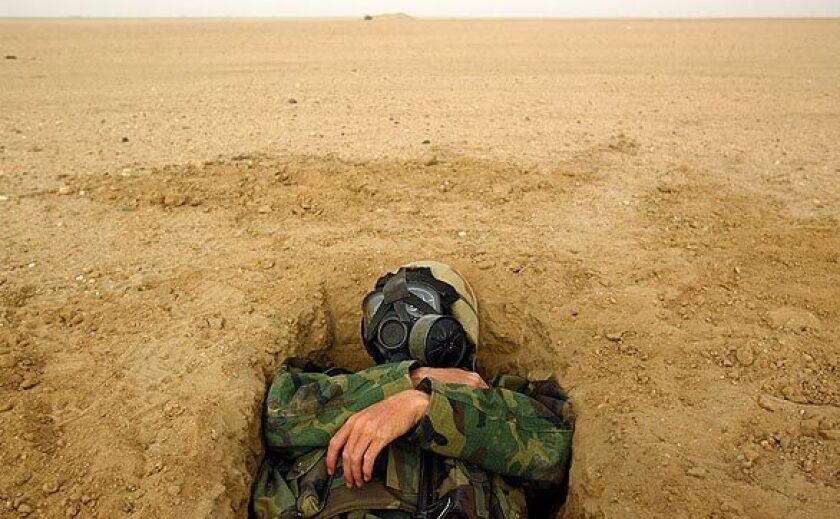On the first day of the invasion, after U.S. forces launched a thundering bomb and missile attack on Baghdad at dawn, in neighboring Kuwait, Marine Cpl. Philip Sturm hunkers down amid reports of Iraqi missile attacks and artillery fire. U.S. ground forces are stationed there as they await orders to deploy. See 'Sirens, Booms, a Call to Prayer' for a Times' report on the first moments of the invasion from the ground in Baghdad. How did the U.S. get to this point? Read the Times' 'Iraq Demystified: a Primer on Politics, History' for a quick tutorial.