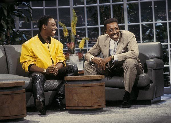 """""""Coming to America"""" costars Eddie Murphy and Arsenio Hall pal around on the set of the syndicated """"The Arsenio Hall Show"""" (1989-1994)."""