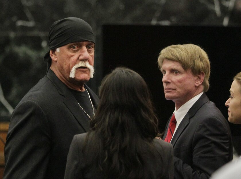 FILE - In this Monday, March 21, 2016, file photo, Hulk Hogan, whose given name is Terry Bollea, left, looks on in court moments after a jury returned its decision in St. Petersburg, Fla. Billionaire tech investor Peter Thiel has been secretly funding Hulk Hogan's lawsuit against Gawker Media for p