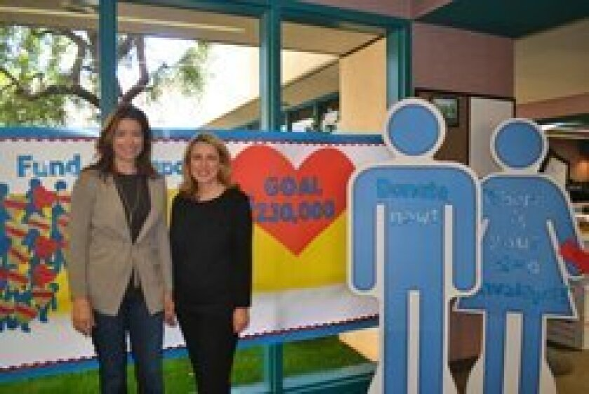 Parent volunteers Holly Bauer and Nora Balikian co-chair the school's Red Envelope Campaign.