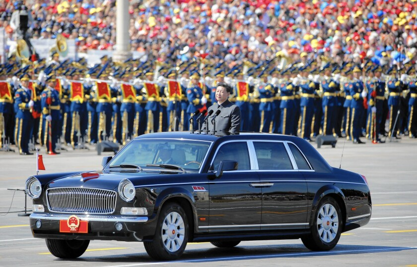 Chinese President Xi Jinping, seen reviewing the troops during a Beijing parade in early September, will start his U.S. visit in Seattle.