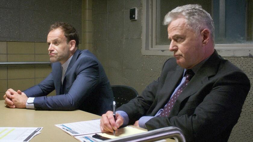 """Jonny Lee Miller, left, and Aidan Quinn in """"Elementary"""" on CBS."""