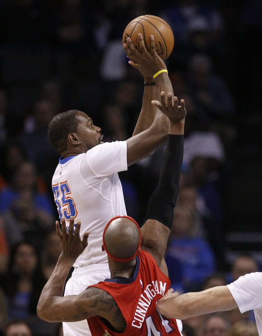 Oklahoma City Thunder forward Kevin Durant (35) shoots in front of New Orleans Pelicans forward Dante Cunningham (44) in the first quarter of an NBA basketball game in Oklahoma City, Thursday, Feb. 11, 2016. (AP Photo/Sue Ogrocki)