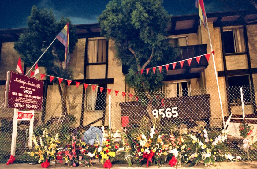 Flowers line a fence at the Northridge Meadows apartment complex a week after the Northridge earthquake.