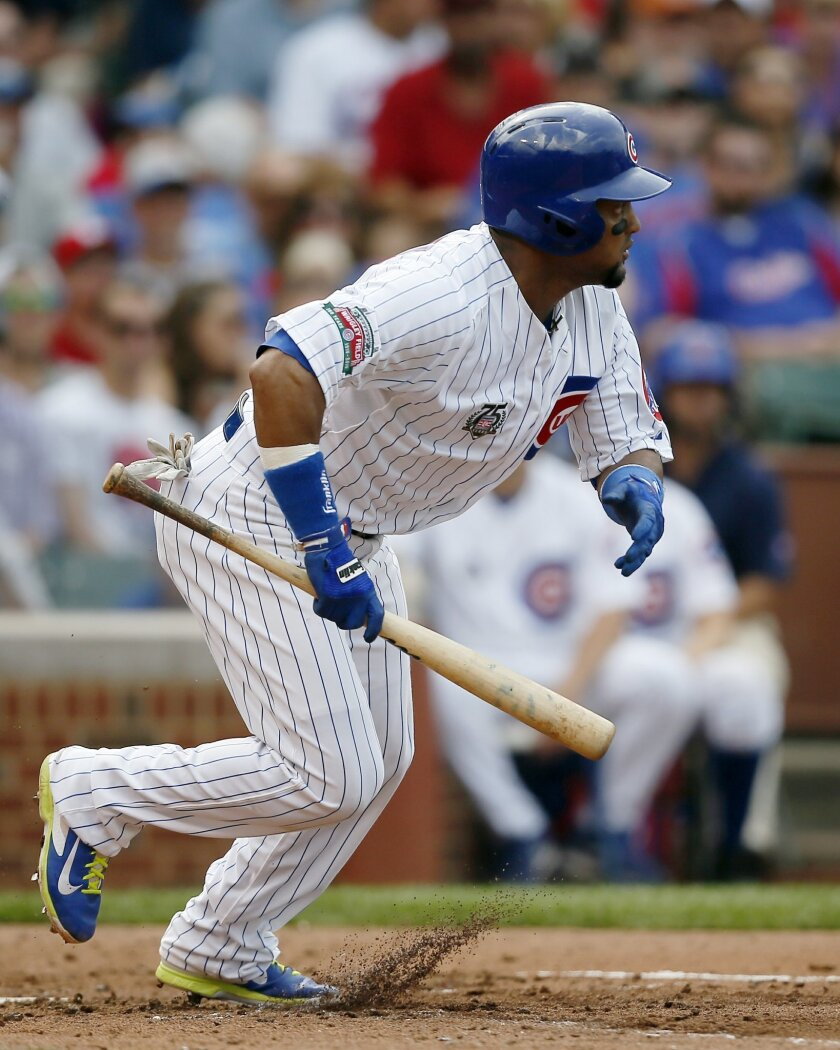 Chicago Cubs' Emilio Bonifacio runs to first on a bunt-single against the St. Louis Cardinals during the fourth inning of a baseball game on Saturday, July 26, 2014, in Chicago. (AP Photo/Andrew A. Nelles)