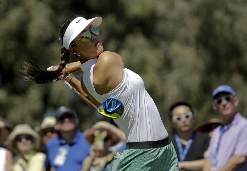 Michelle Wie watches her tee shot on the second hole during the third round of the LPGA Tour ANA Inspiration golf tournament at Mission Hills Country Club, Saturday, April 2, 2016, in Rancho Mirage, Calif. (AP Photo/Chris Carlson)