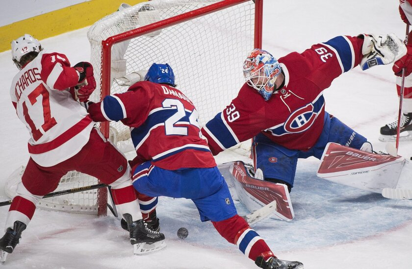 Montreal Canadiens goaltender Mike Condon makes a save against Detroit Red Wings' Brad Richards as Canadiens' Phillip Danault defends during the second period of an NHL hockey game, Tuesday, March 29, 2016 in Montreal. (Graham Hughes/The Canadian Press via AP) MANDATORY CREDIT