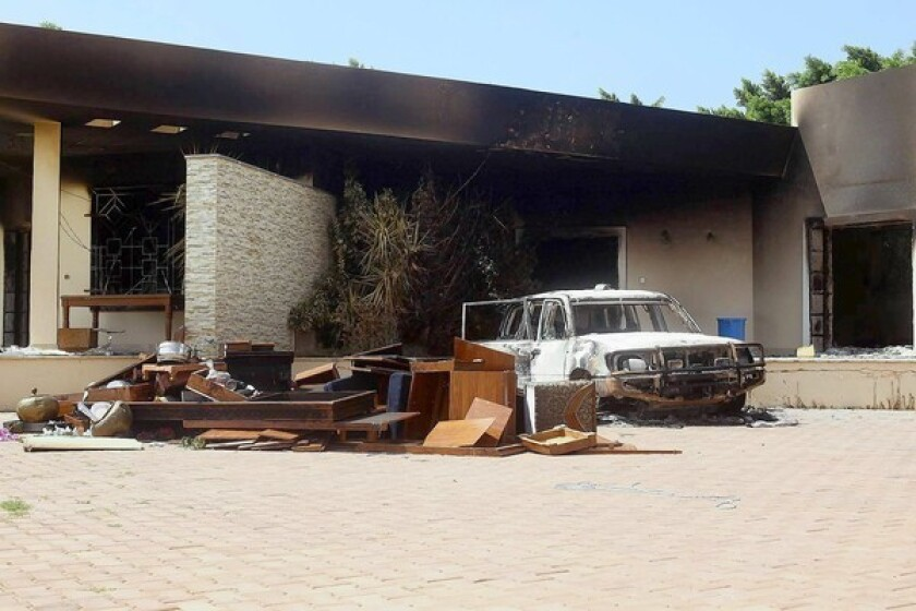 A burned car is visible after the deadly U.S. consulate attack in Benghazi, Libya. An FBI team visited the site this week.