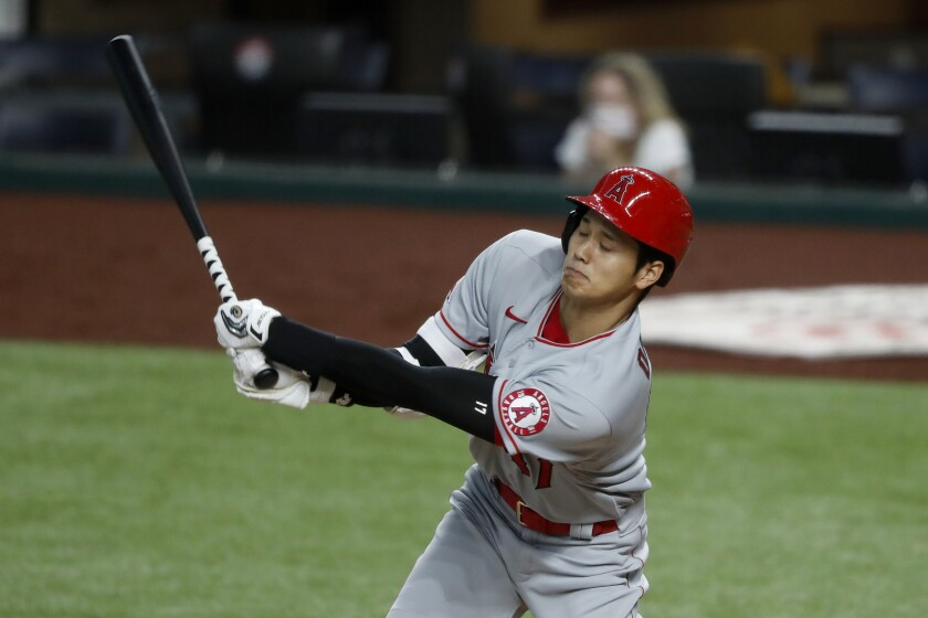 The Angels' Shohei Ohtani swings at a pitch in the sixth inning Aug. 8, 2020.