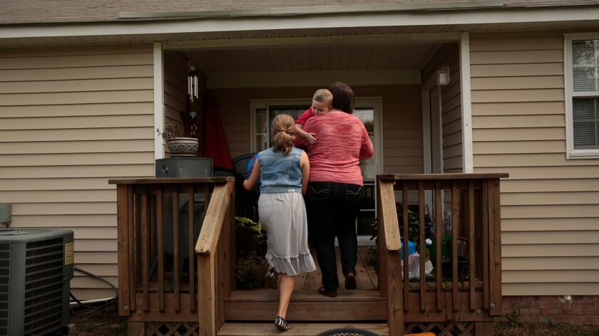 FORT BRAGG, NORTH CAROLINA--SEPT. 10, 2014--Lori Ballard takes care of her two children, Emily, 11 1