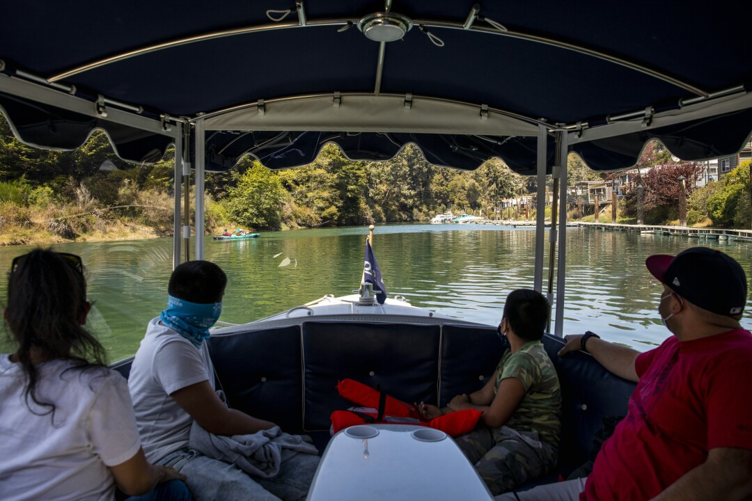 Visitors view the scenery on a boat tour
