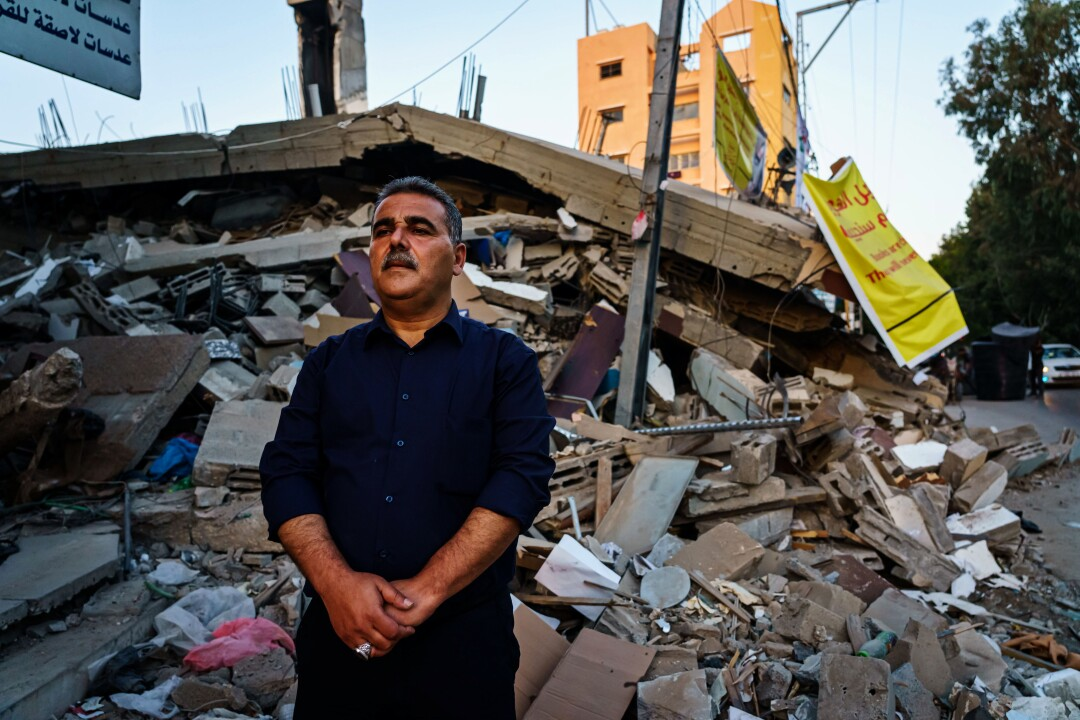 Samir Mansour in front of the ruins of his bookstore