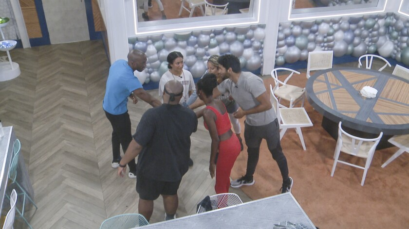 Six reality show contestants circle up