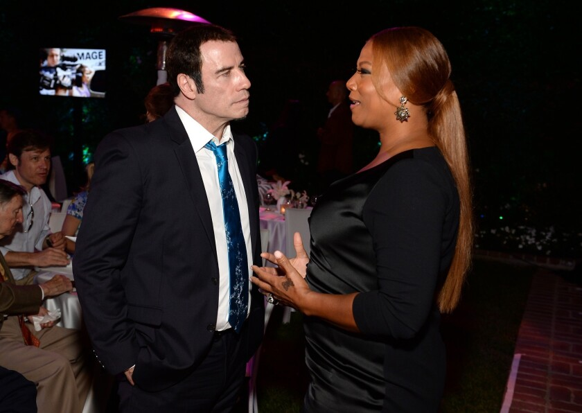 John Travolta and Queen Latifah at Tony Bennett's 87th birthday celebration Aug. 3 in Beverly Hills.