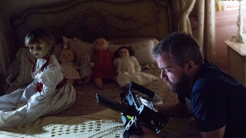 "Director David F. Sandberg preps his star for a scene in ""Annabelle: Creation"""