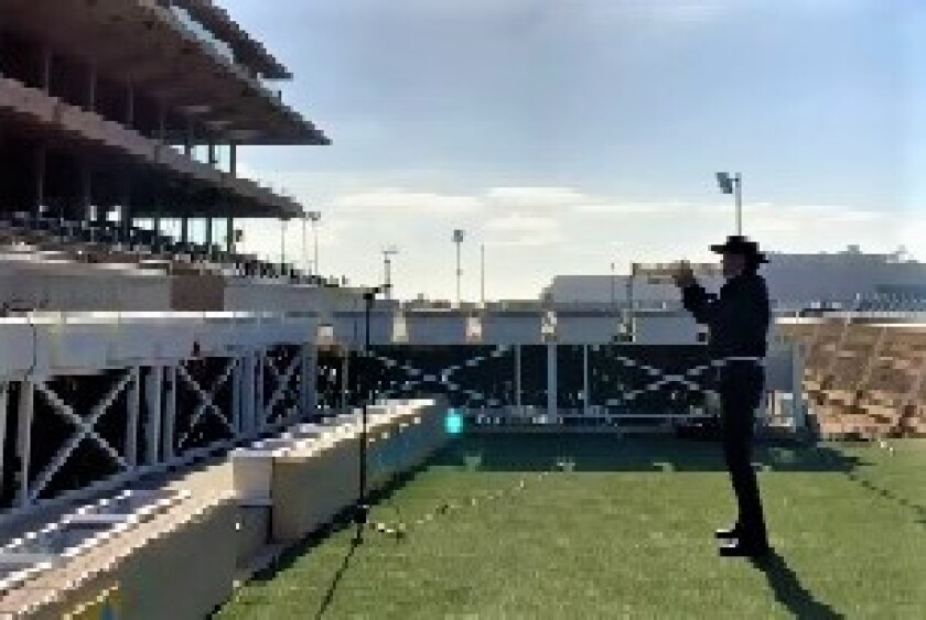 Trumpeter Les Kepics played as horses came onto the Del Mar track during the COVID-19 pandemic.