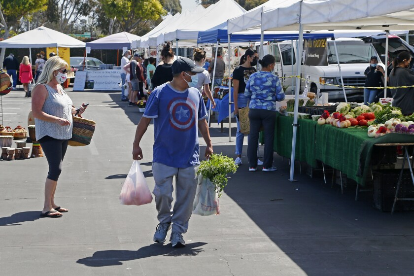Shoppers explore the various vendors during the Farmers Market in April at the O.C. fairgrounds.