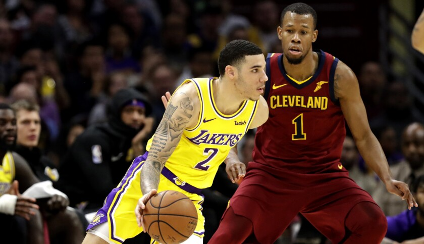 Lakers guard Lonzo Ball drives past Cavaliers guard Rodney Hood during the first half Wednesday night in Cleveland.