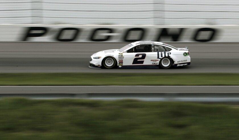 Brad Keselowski drives through Turn 3 during qualifying for Sunday's NASCAR Sprint Cup Series auto race, Friday, June 3, 2016, in Long Pond, Pa. Keselowski won the pole. (AP Photo/Matt Slocum)