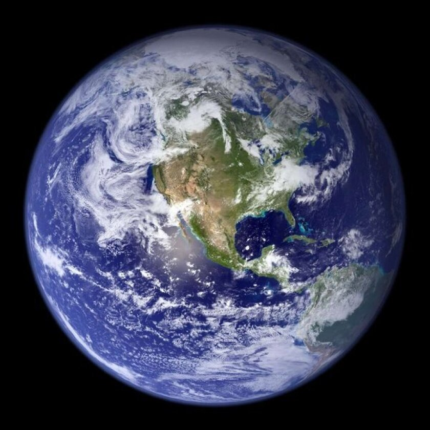 Carbon emissions warm Earth's surface but cool the upper atmosphere, scientists explained Sunday in the journal Nature Geoscience.