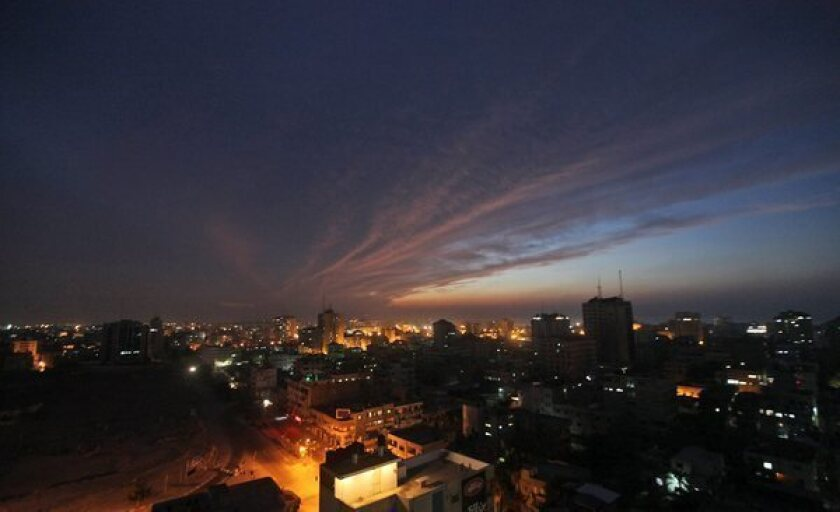 A panoramic view of Gaza City at dusk.