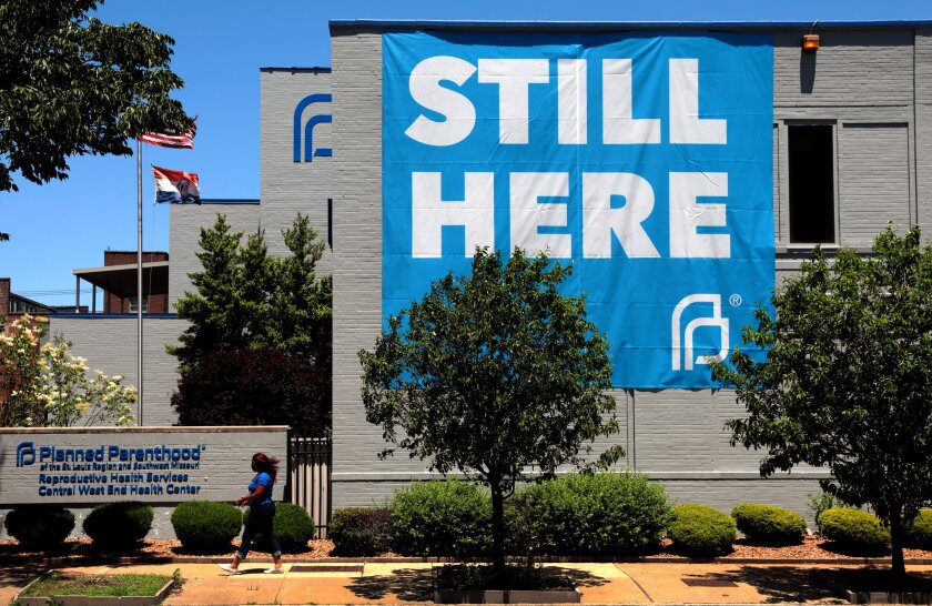 FILE - In this May 29, 2020, file photo, a banner hangs on the side of the Planned Parenthood building in St. Louis. A full federal appeals court panel is rehearing a case over Missouri abortion restrictions. The U.S. 8th Circuit Court of Appeals last week decided to take up the case on its own motion. At issue is a 2019 state law to ban abortions as soon as eight weeks into pregnancy and prohibit abortions based on a Down syndrome diagnosis. (Robert Cohen/St. Louis Post-Dispatch via AP, File)