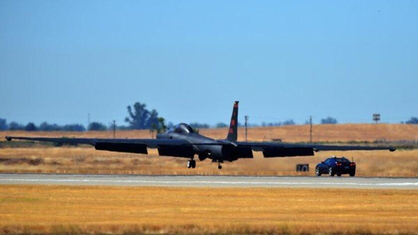 2012 Chevrolet Camaro SS escorts a U-2 spy plane down the runway.