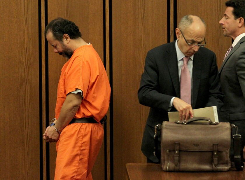 Ariel Castro walks past his attorneys Jaye Schlachet, center, and Craig Weintraub after his second pre-trial hearing two weeks ago.