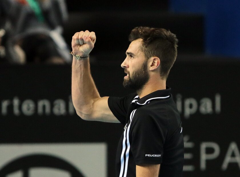 France's Benoit Paire reacts after winning a point against Stanislas Wawrinka of Switzerland, during their quarter final match at the Open 13 Provence tennis tournament, in Marseille, southern France, Friday Feb. 19 , 2016. (AP Photo/Claude Paris)