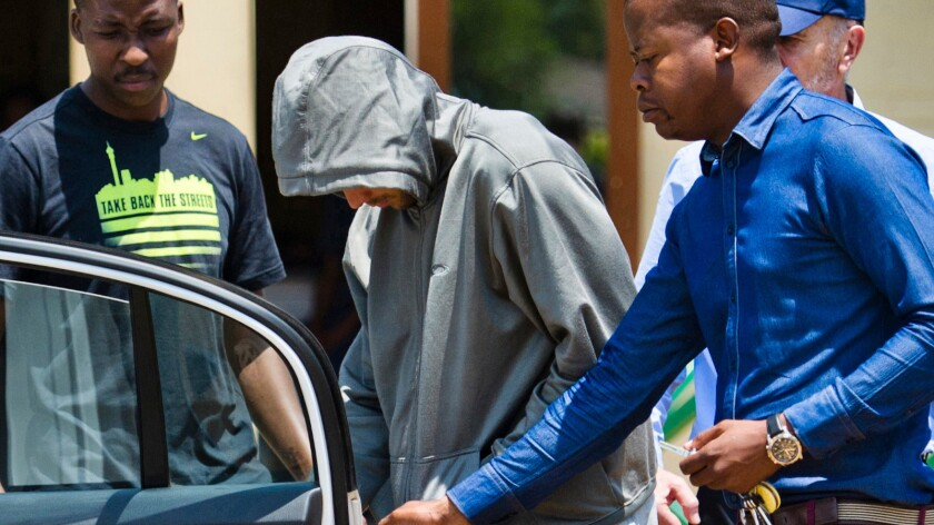 Oscar Pistorius leaves police custody after his arrest in February 2013.