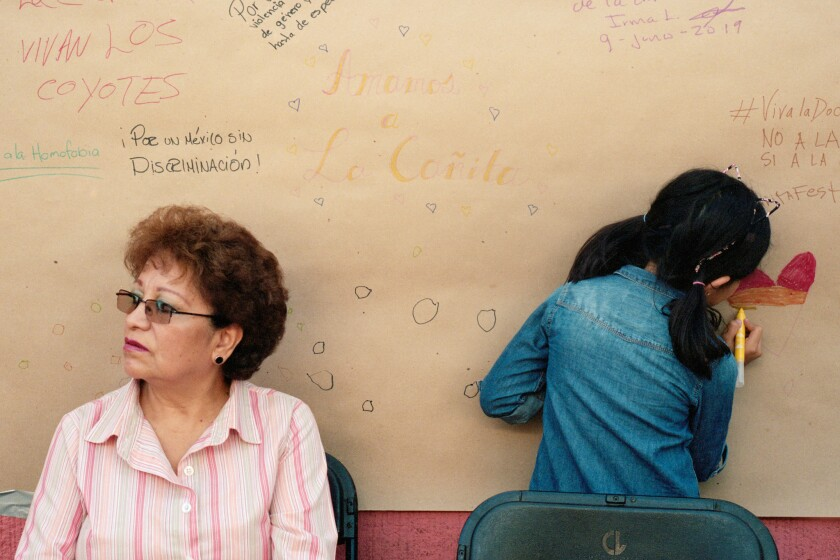 June 9, 2019 - Mexico City, Mexico: Left, Marta Flores, 63, a Doctores resident, in front of a poste