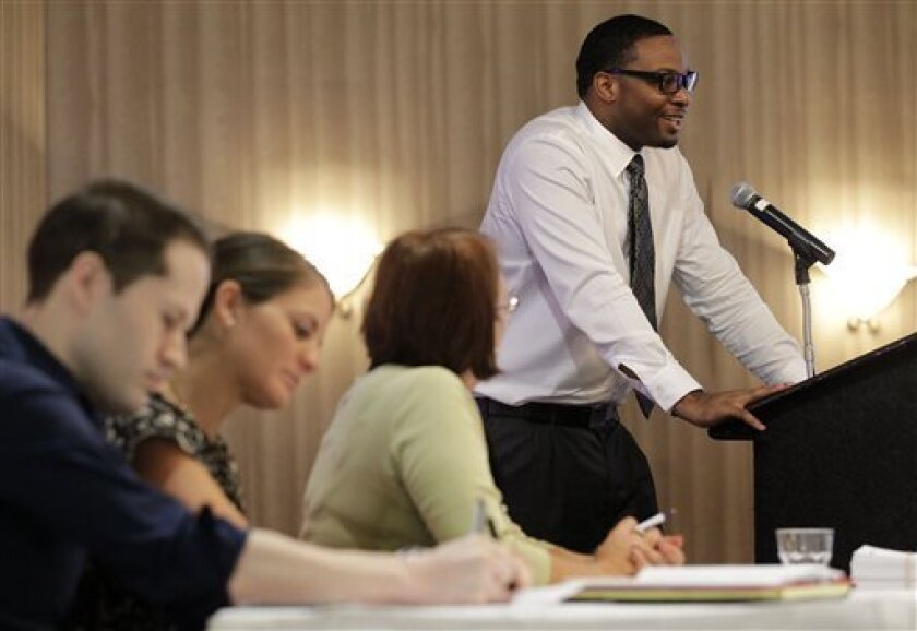 In this Thursday, Oct. 11, 2012, photo, a panel of Spirit Airlines employees make notes and listen as applicant Anthony Williams, top right, addresses a room full at a Flight Attendant Open House, in Dallas. The airline announced that it is hiring 250 positions that include flight attendants, pilots and mechanics to be based out of its newly announced crew base at Dallas-Fort Worth International Airport. U.S. employers advertised more job in October than September, a hopeful sign that hiring could pick up in the coming months. (AP Photo/Tony Gutierrez)