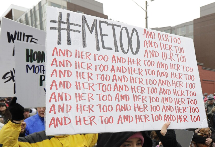 Protester carries a #MeToo sign