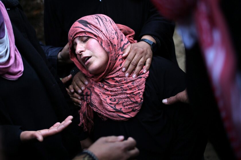 The mother of slain Palestinian militant Ahmed Zaanin grieves at his funeral in Beit Hanoun in the Gaza Strip.