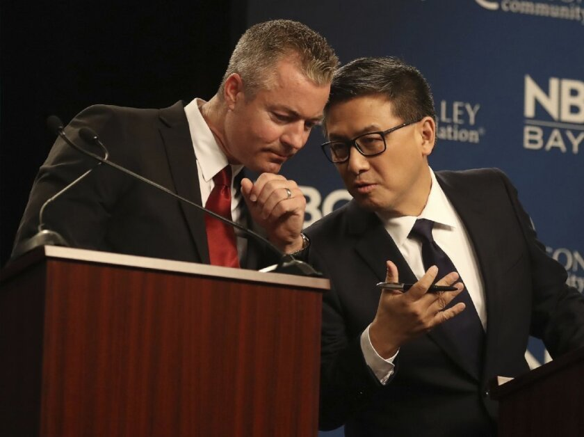 Republican gubernatorial candidate Travis Allen, left, talks with Democratic candidate John Chiang during a debate at the California Theatre, Tuesday, May 8, 2018, in San Jose, California.