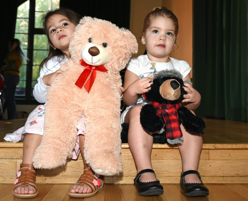 Miriam Green and Jasmine Puckett with donated teddy bears at the 2019 Teddy Bear Tea.