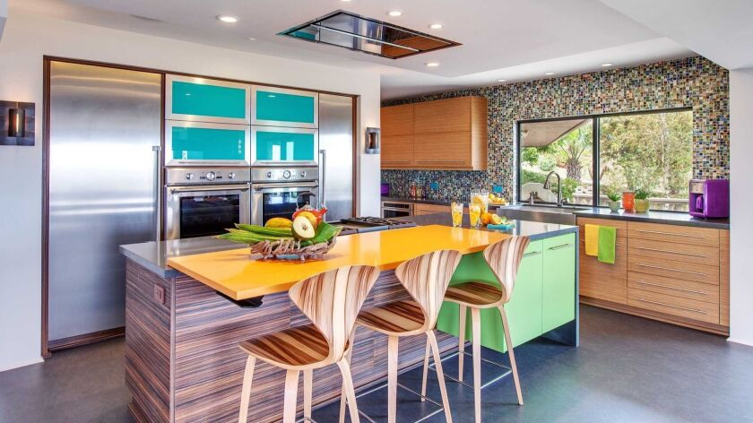 Kitchens are seeing colorful updates. Photo courtesy of Jackson Design and Remodeling