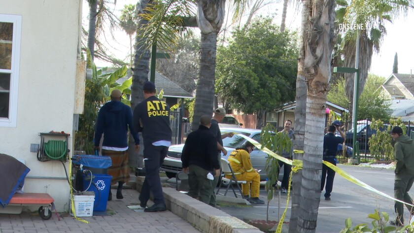 Investigators work outside an Escondido mosque after an arson fire