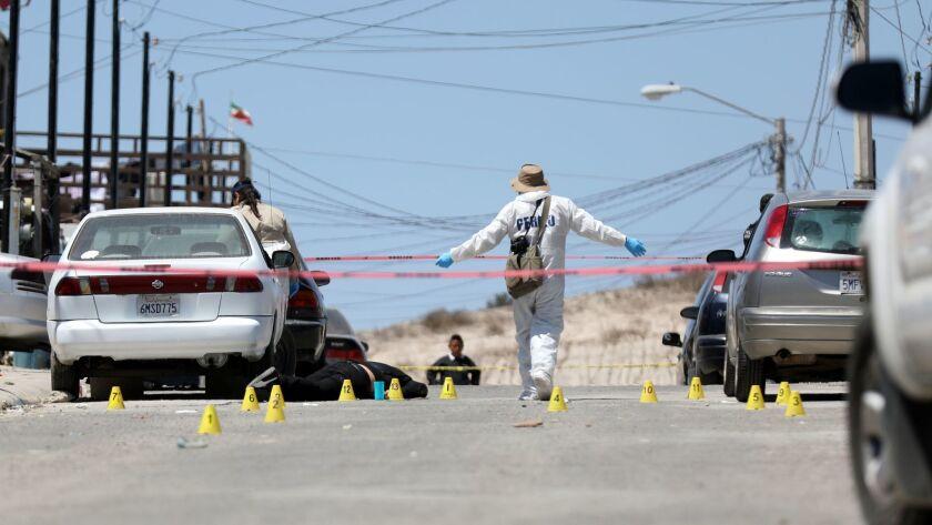 TIJUANA, BAJA CALIF. -- FRIDAY, JUNE 1, 2018: Investigators check the scene of a homicide in Tijuana