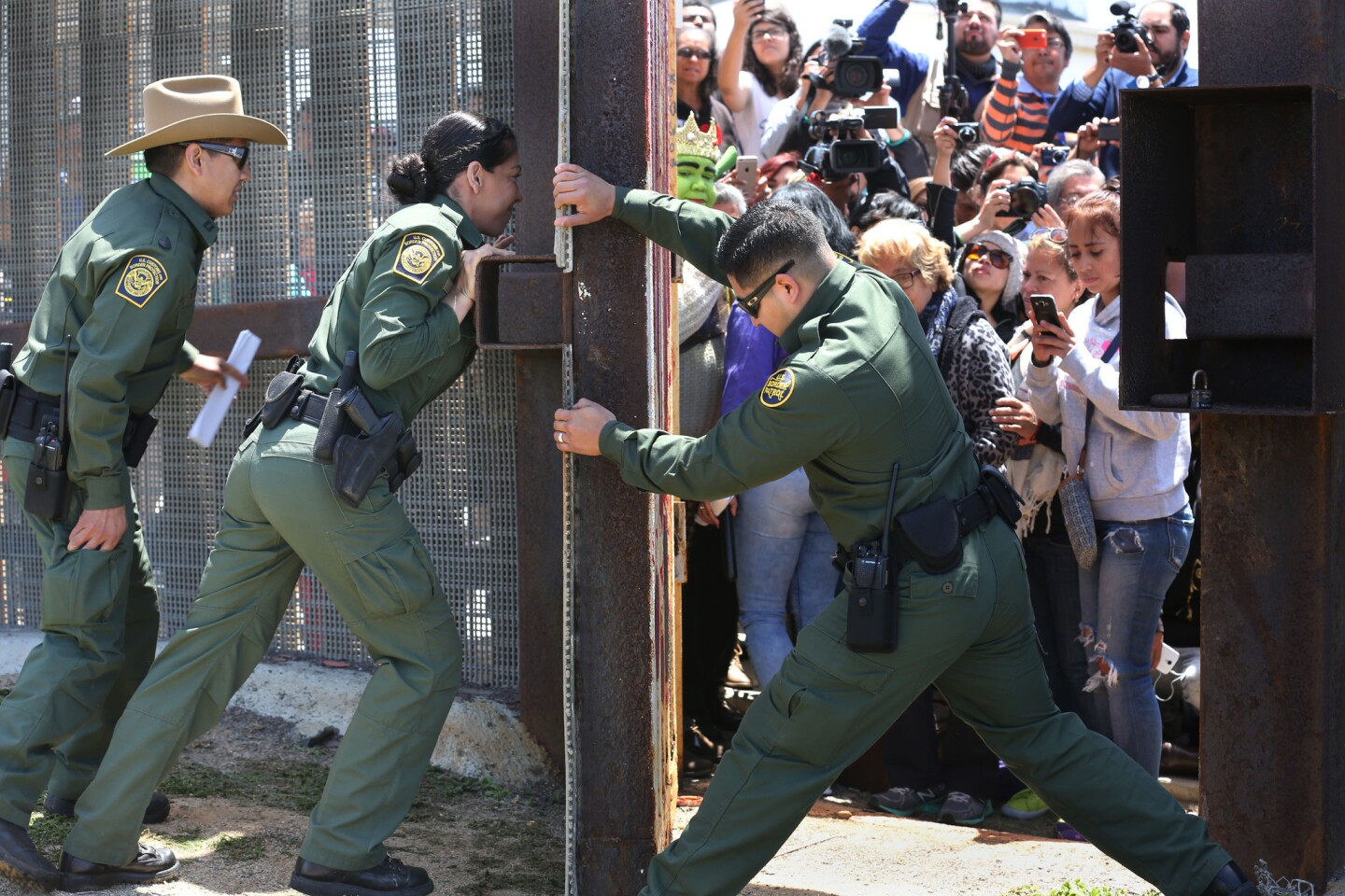 Border Patrol agents close the famous Door of Hope at Borderfield State Park