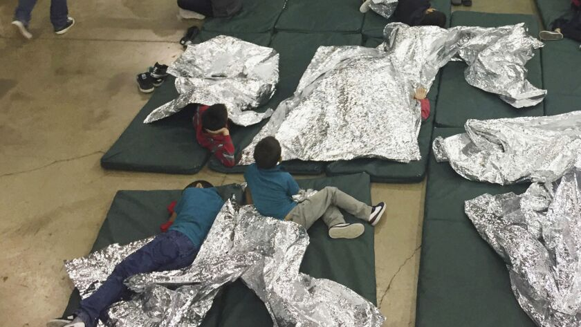 FILE - In this Sunday, June 17, 2018, file photo provided by U.S. Customs and Border Protection, peo