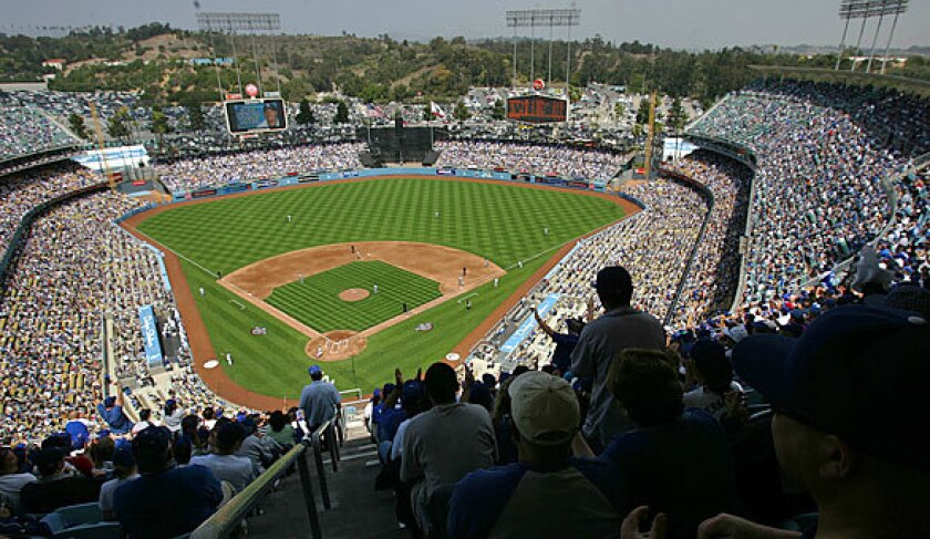 Fans cheer at a sold-out opening day game at Dodger Stadium.