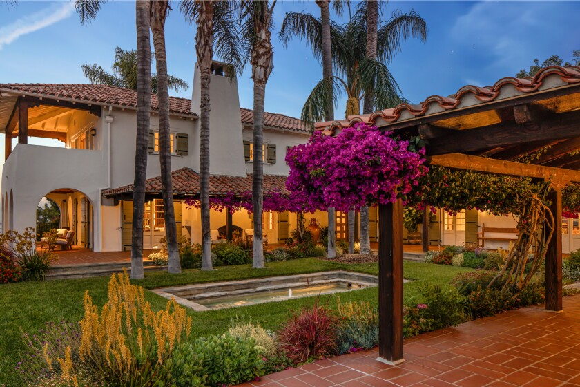 The 3-acre spread includes a 1920s main house, guesthouse, recording studio, movie theater and glass funicular that runs from the pool to the tennis court.
