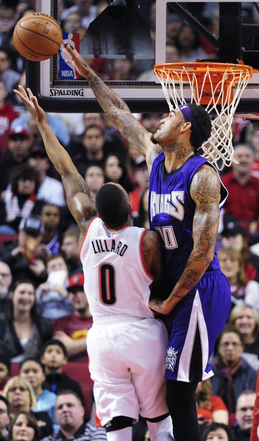 Sacramento Kings center Willie Cauley-Stein (00) blocks the shot of Portland Trail Blazers guard Damian Lillard (0) during the first half of an NBA basketball game in Portland, Ore., Tuesday, Jan. 26, 2016. (AP Photo/Steve Dykes)