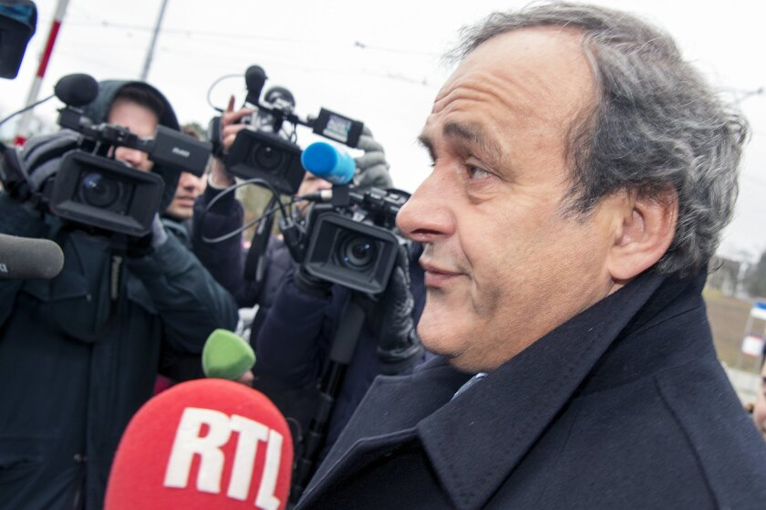 Suspended  UEFA President Michel Platini arrives at the FIFA Headquarters  in Zurich, Switzerland, Monday, Feb.  15, 2016. Michel Platini's appeal against his eight-year ban from all football-related activity will be heard by FIFA's appeals committee today.  (Walter Bieri/Keystone via AP)